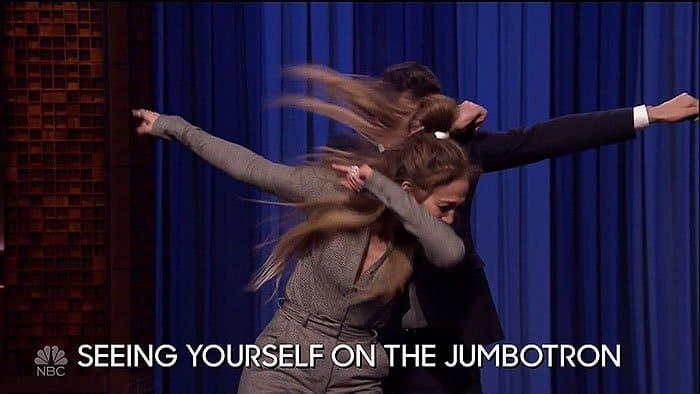 Jennifer Lopez dabbing with Jimmy Fallon during their dance battle