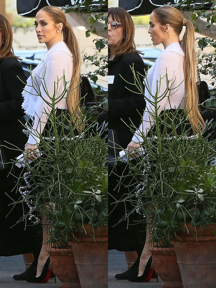 """Jennifer Lopez wore her long """"bronde"""" hair in a center-parted ponytail"""