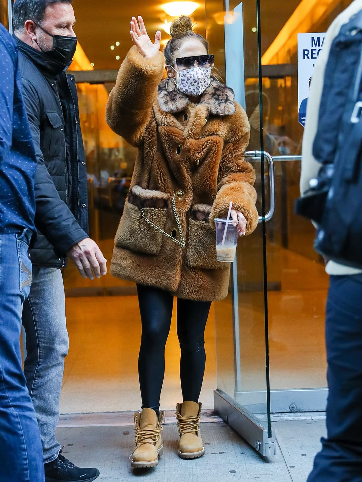Jennifer Lopez wears a Coach x Schott NYC shearling coat with leggings and Timberland x Jimmy Choo boots