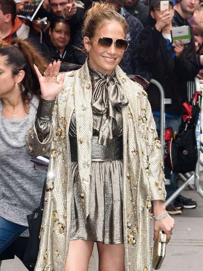 Jennifer Lopez wears Saint Laurent lamé pussy-bow blouse and skirt coordinates