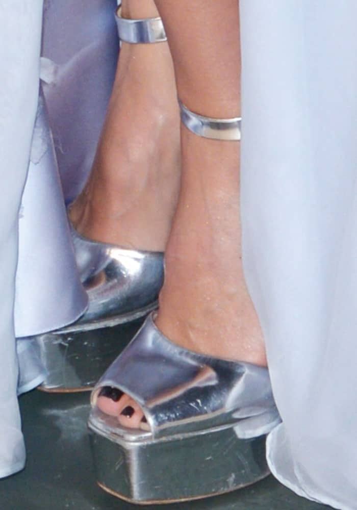 Jessica towers in a pair of Giuseppe Zanotti Betty platform sandals