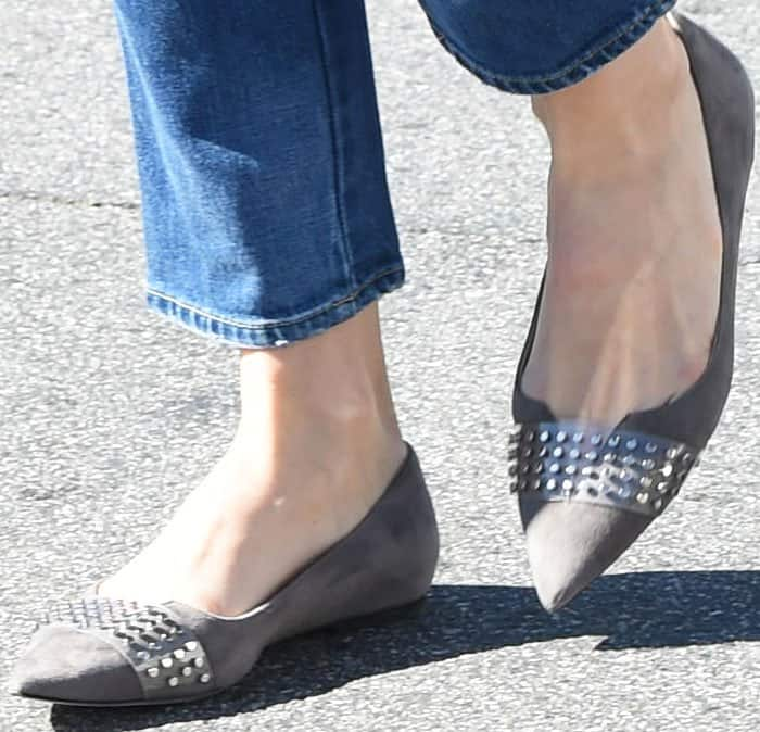 Comfy and stylish: Jessica steps out in a pair of studded Jimmy Choo flats