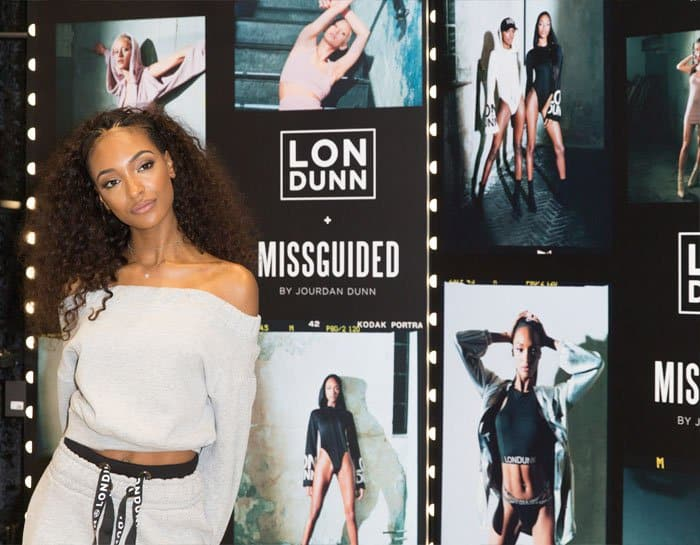 Jourdann poses alongside her LonDunn + Missguided campaign posters