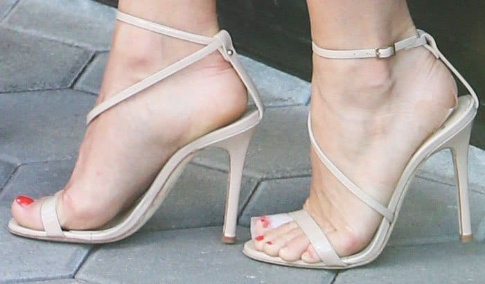 "Julianne dons the sexy and strappy Alexander White ""Hara"" sandals"