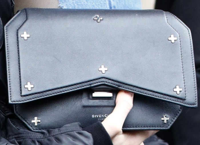 Kendall shows off her cross-embellished Givenchy clutch