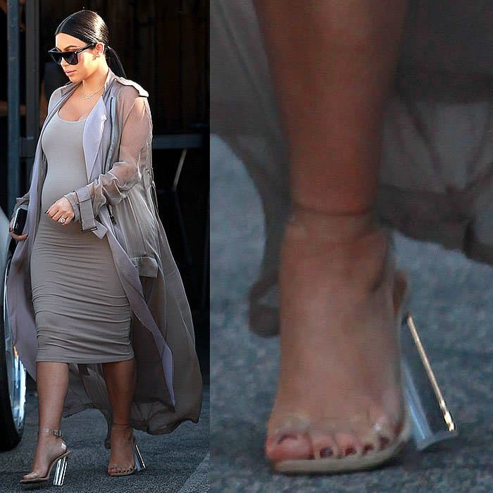 e92605ca47 Heavily pregnant Kim Kardashian in Yeezy season 2 clear sandals with  perspex heels that look like