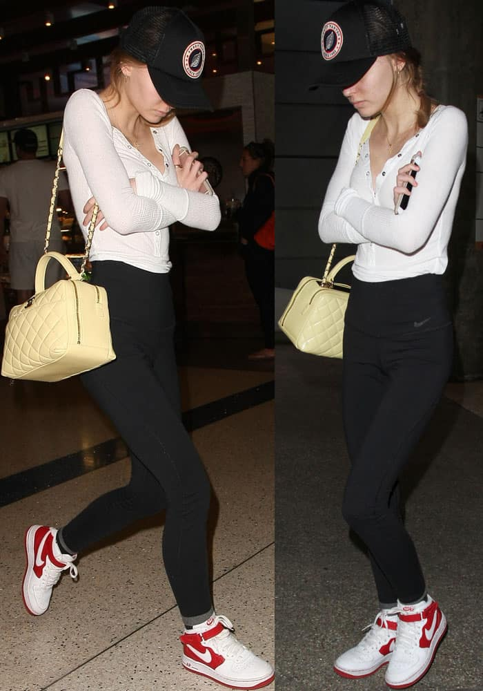 Lily-Rose avoids the camera flashes as she walked through LAX