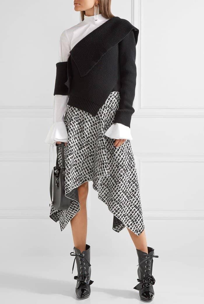 Model wearing Loewe's curved heel bow booties