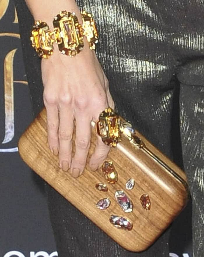 Louise went a little eccentric by pairing metallic with a wooden clutch