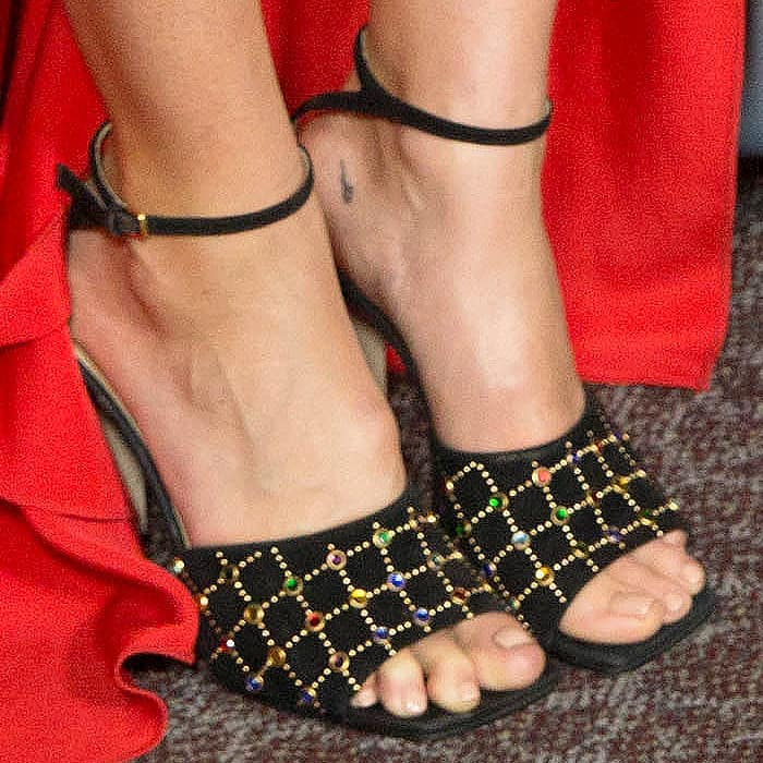 "Closeup of the Sergio Rossi ""SR1"" suede sandals wiyh multicolor glass gems on Mandy Moore."
