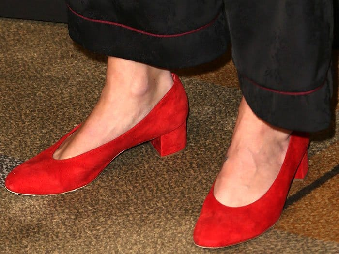 Closeup of the Mansur Gavriel red-suede ballerina pumps on Melissa Benoist.