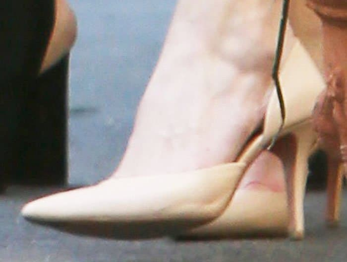 Michelle balances out the pink with her nude Céline d'orsay pumps