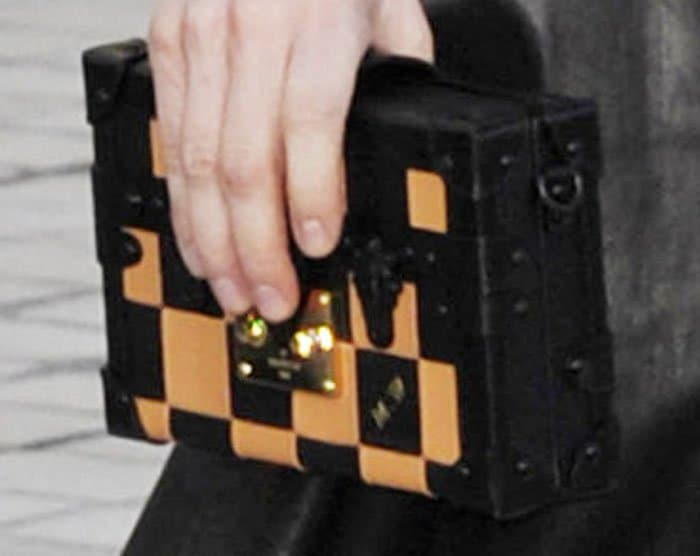 The actress dons one of Louis Vuitton's infamous rectangular clutches