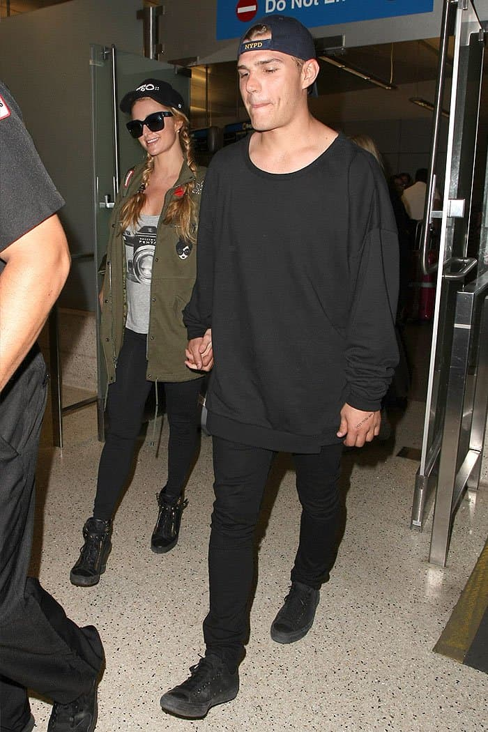 Paris Hilton holding hands with her boyfriend Chris Zylka as they arrive at the LAX airport in Los Angeles, California, on March 15, 2017.