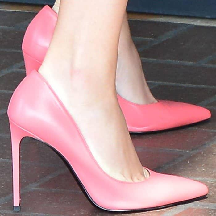 "Reese wears her pink Saint Laurent ""Paris"" pumps"