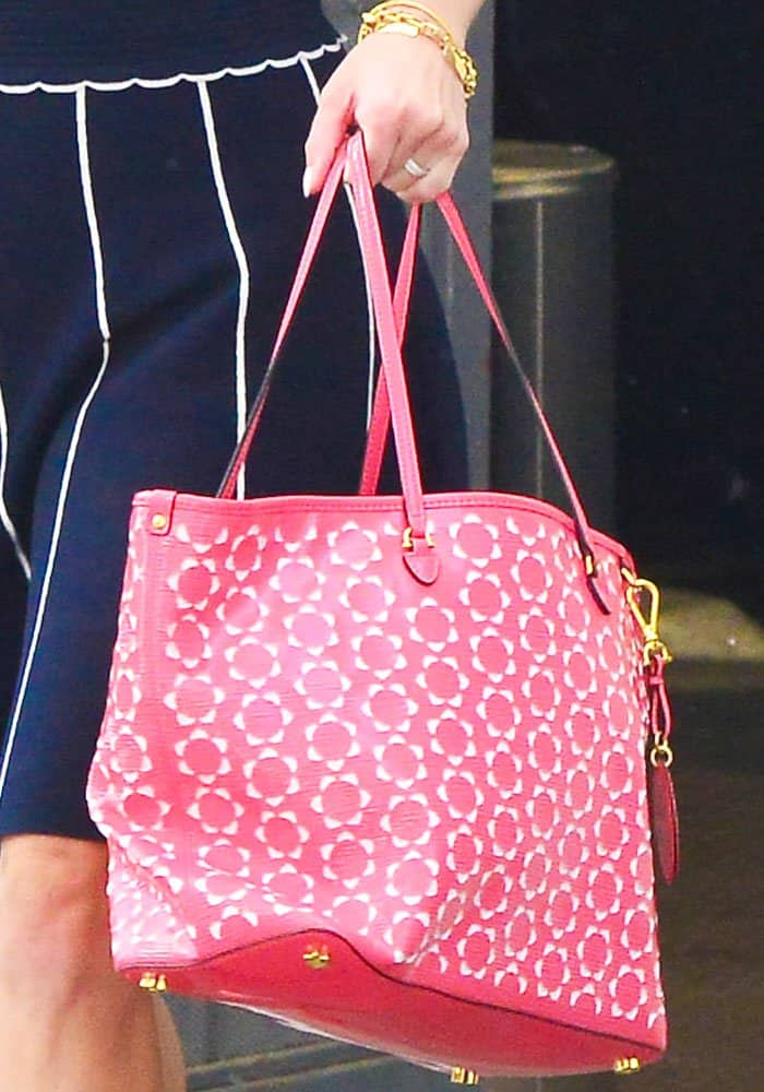 The actress shows off a tote from her Draper James bag line