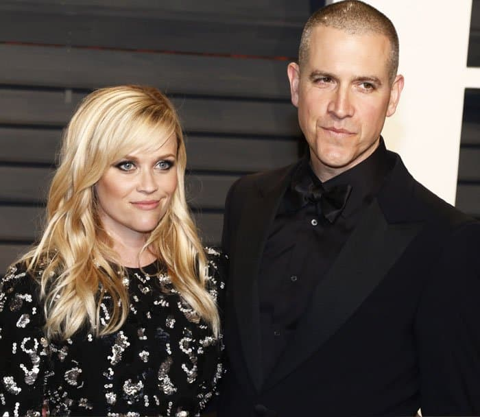 Reese poses with her husband, Jim Toth