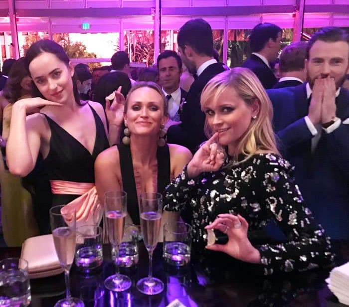 Reese and her friends Dakota Johnson and Emily Ward