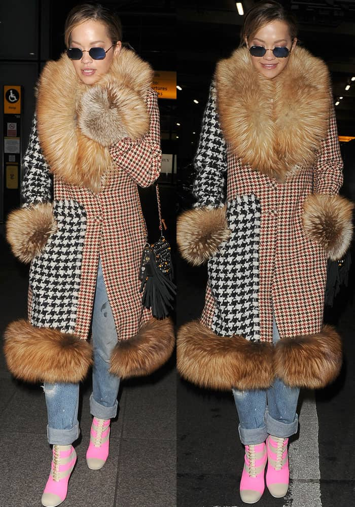 Rita looks like a walking patchwork in her oversized Ellery tweed fur coat and pink Fendi boots