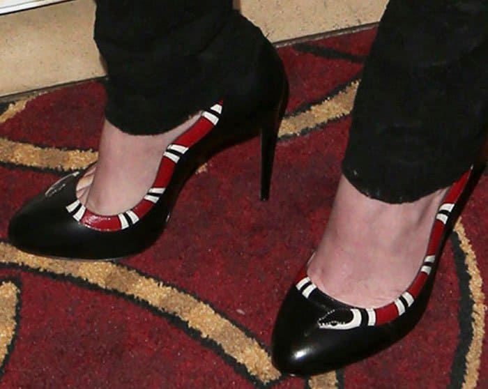 Rumer wears the quirky Yoko snake pumps from Gucci