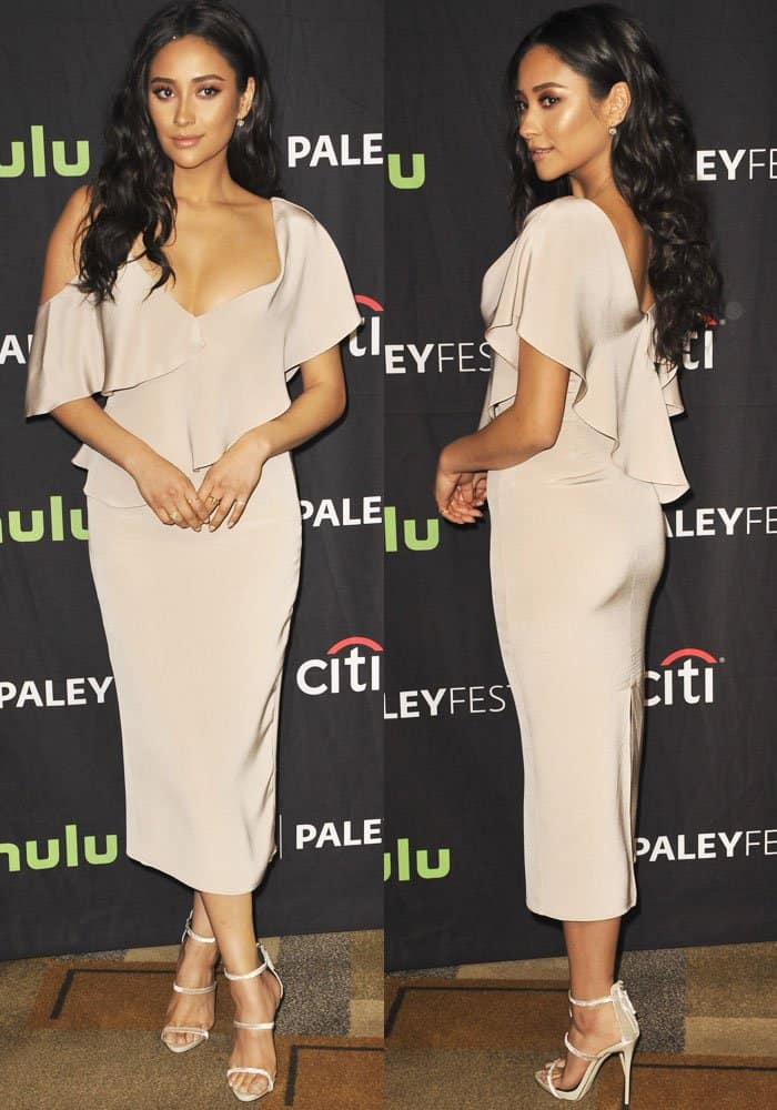 Shay stunned in a cleavage-baring Cushnie et Ochs dress