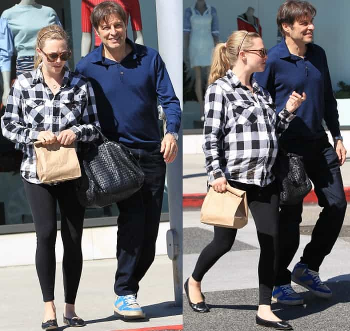 Amanda Seyfried wearing a black and white checkered shirt, black Seraphine leggings, and black ballet flats while out and about in LA