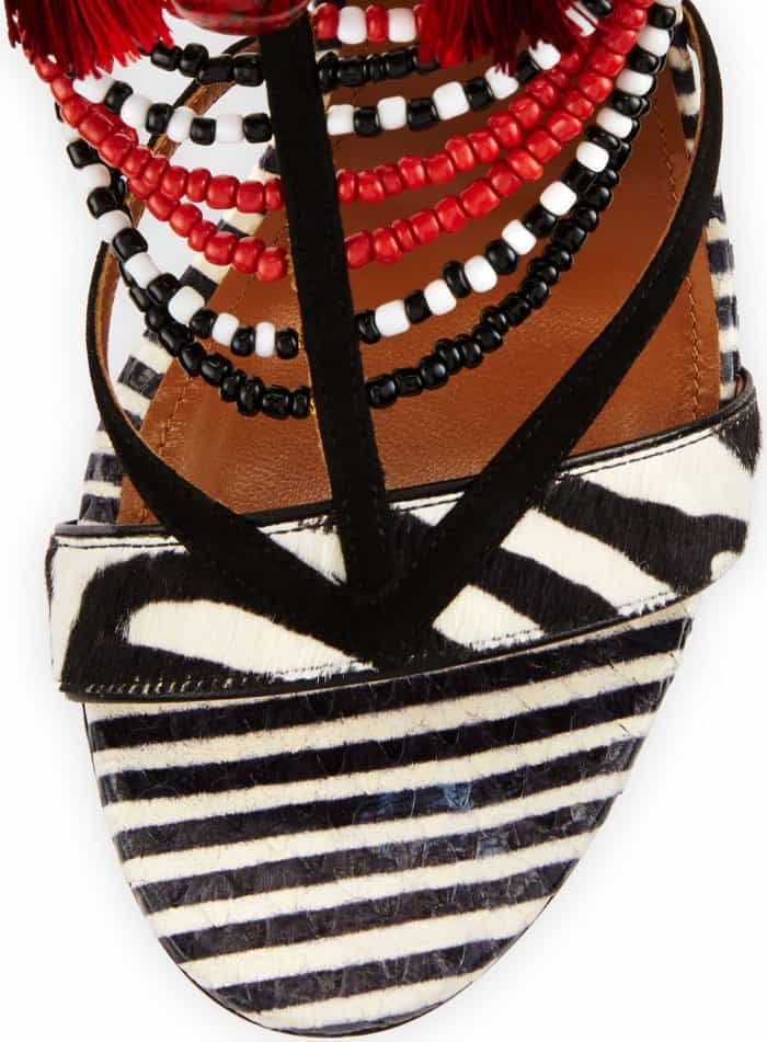 """Masterfully crafted in Italy, the """"Voodoo"""" multi-strap sandals feature printed leather and snakeskin"""