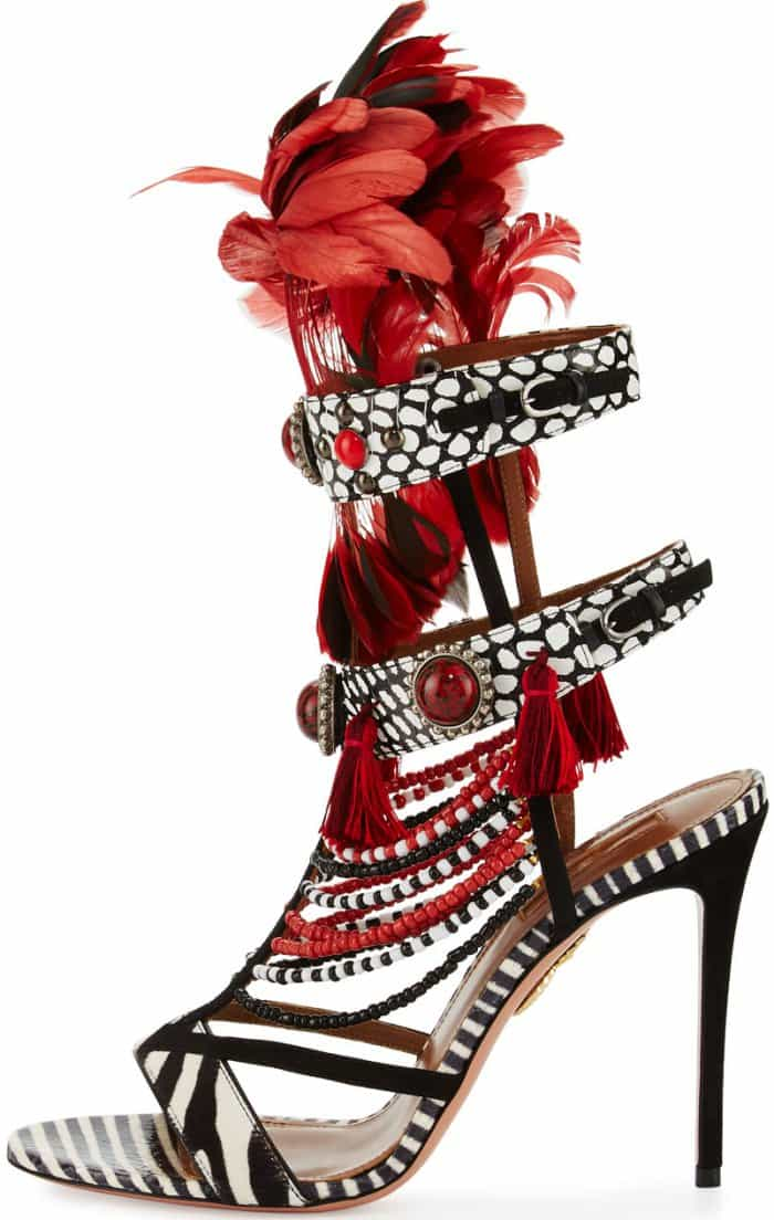 They are adorned with red feathers and embellished with cabochon studs