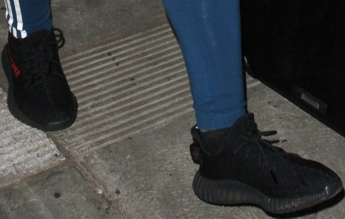Blac Chyna wearing Yeezy Boost 350 V2 Black/Red Sneakers at LAX