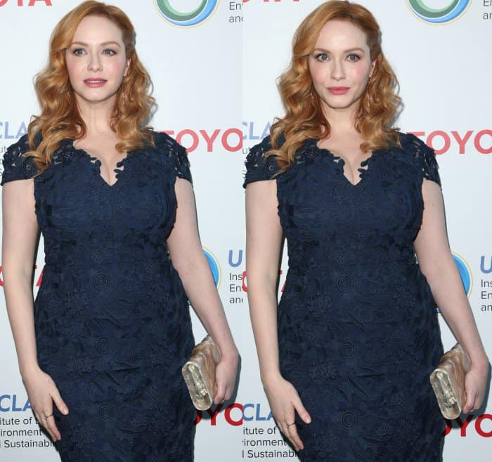 Christina Hendricks wearing a Shoshanna navy lace gown and nude satin pumps at the Innovators for a Healthy Planet Gala