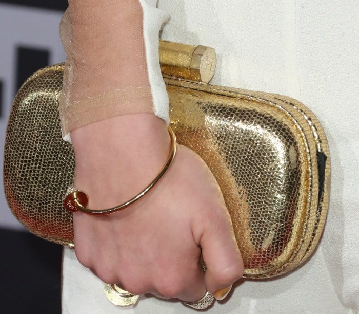 Daya carrying a gold clutch and wearing jewels from Jason of Beverly Hills at the 2017 iHeartRadio Music Awards