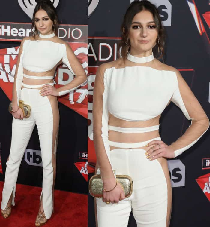 Daya wearing a white jumpsuit from Balmain and sparkly peep-toed heels with mesh panels at the 2017 iHeartRadio Music Awards