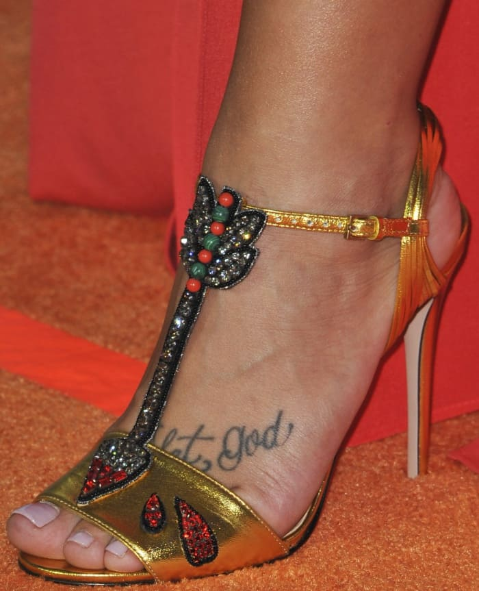 Demi Lovato wearing gold T-strap sandals at the 2017 Kids' Choice Awards