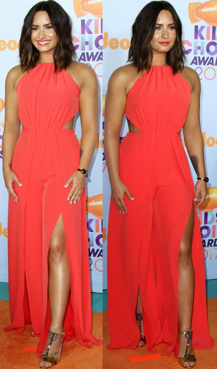 Demi Lovato wearing a Halston Heritage jumpsuit and gold T-strap sandals at the 2017 Kids' Choice Awards