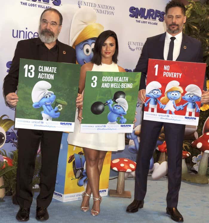"""Demi Lovato with co-stars Mandy Patinkin and Joe Manganiello at the United Nations and """"Smurfs: The Lost Village"""" event"""