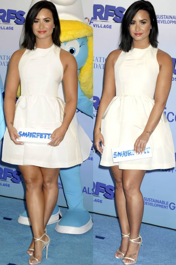 """Demi Lovato flaunts her legs at the United Nations headquarters for the International Day of Happiness in conjunction with the """"Smurfs: The Lost Village"""" event"""