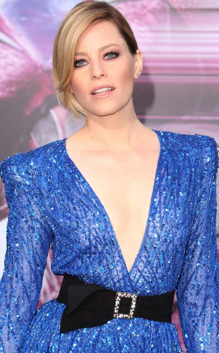 "Elizabeth Banks wearing a blue embellished jumpsuit from Zuhair Murad and ""Paloma"" black satin pumps from Charlotte Olympia at the ""Power Rangers"" LA premiere"