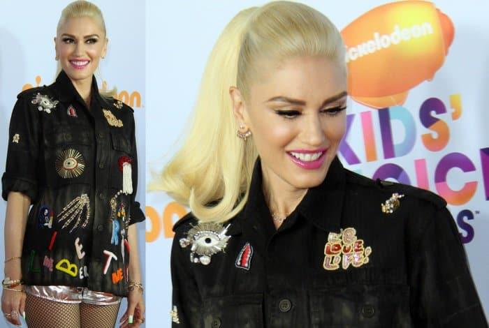 Gwen Stefani wearing a Libertine embroidered shirt and Wanda Inylon metallic shorts at the 2017 Kids' Choice Awards