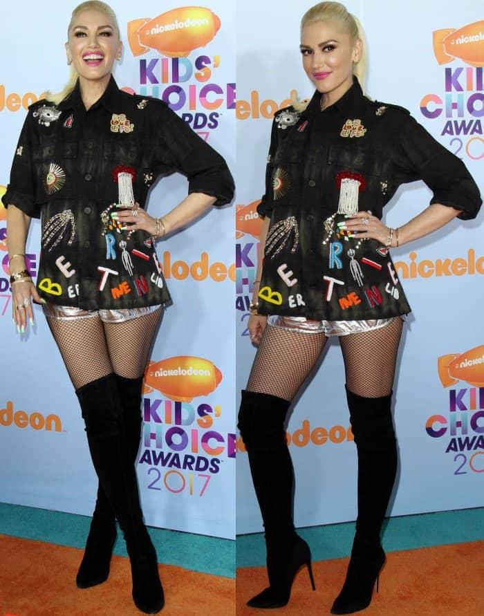 Gwen Stefani wearing a Libertine embroidered shirt and Wanda Nylon metallic shorts at the 2017 Kids' Choice Awards