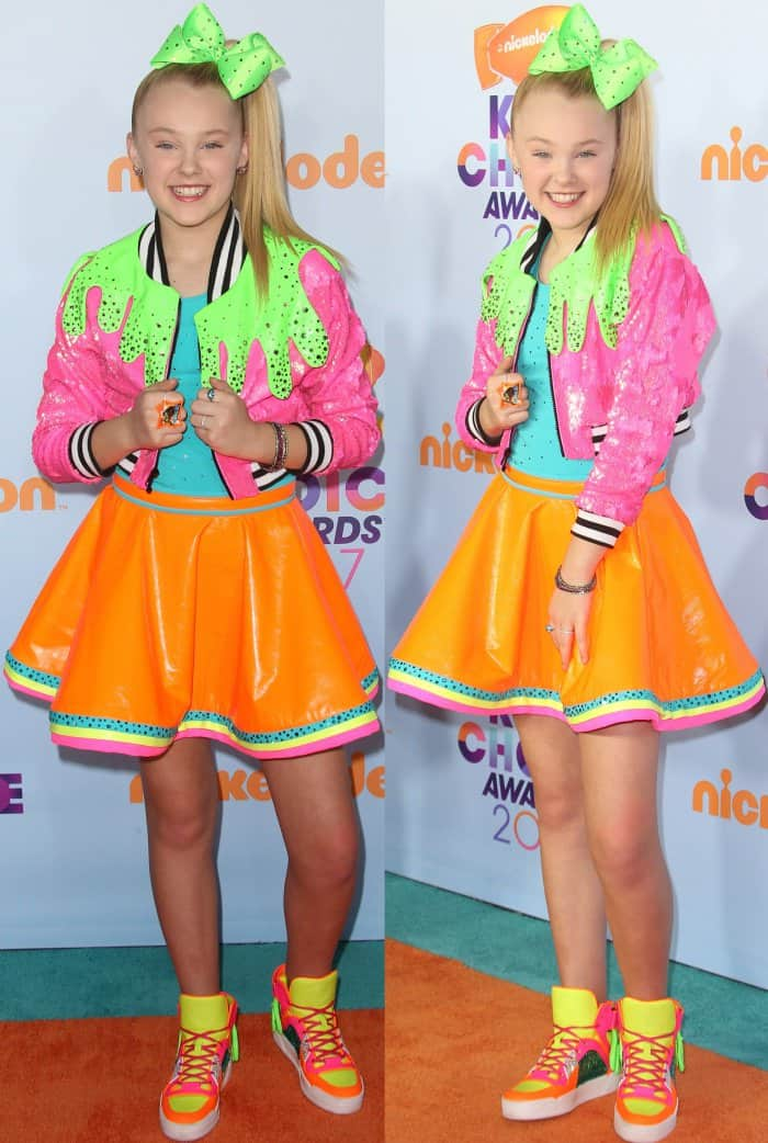 Jojo Siwa wearing a pink embellished jacket, turquoise top, orange leather skirt, and multicolored sneakers at the 2017 Kids' Choice Awards