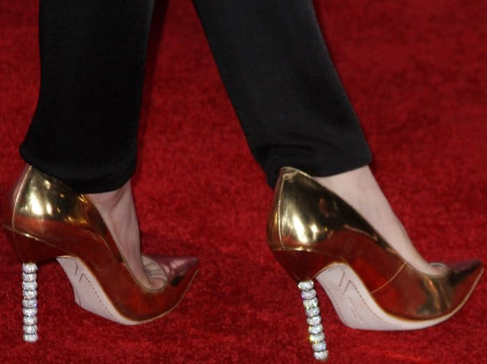 Kiernan Shipka wearing gold Sophia Webster 'Coco Crystal' pumps