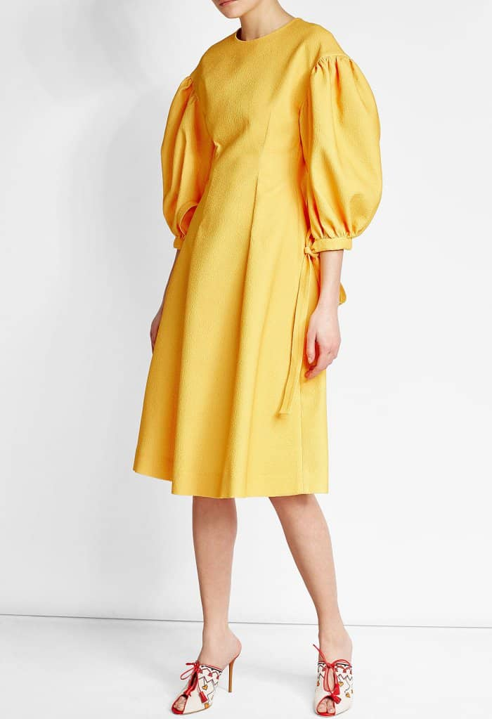 Model wearing Malone Souliers x Natalia Vodianova Linen Mules with Tassels and Rejina Pyo Crepe Dress with Puff Sleeves
