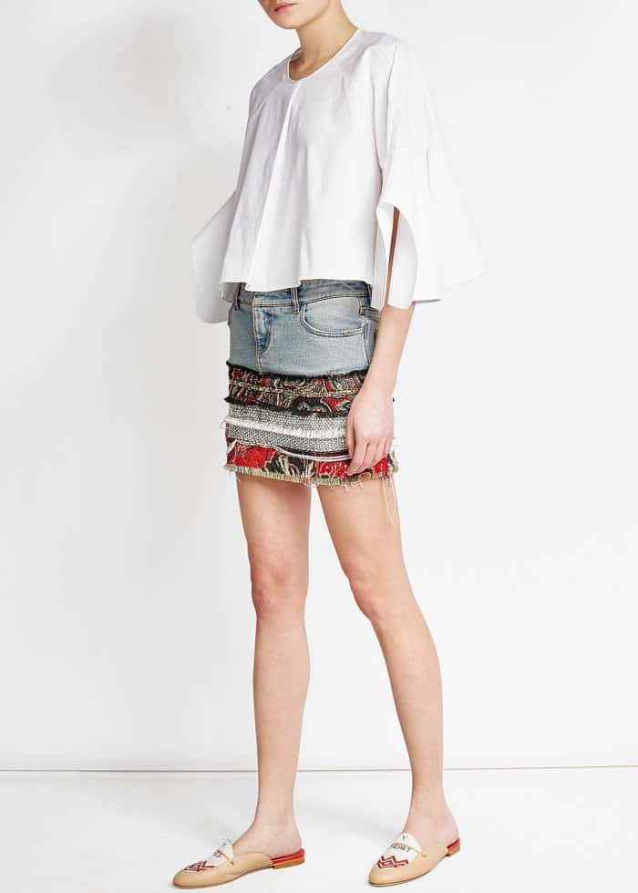 """Model wearing Malone Souliers x Natalia Vodianova """"Neva"""" Leather Slippers with Linen Stitching, Delpozo Cropped Cotton Top, and Faith Connexion Patchwork Denim Skirt"""