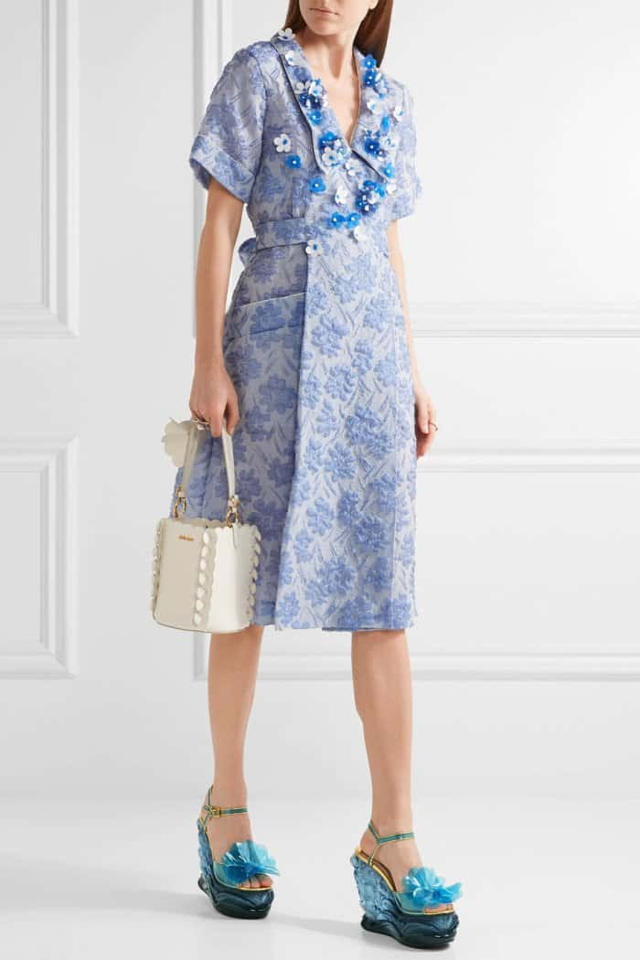 Model wearing the Miu Miu Floral-Appliquéd Silk-Blend Cloqué Wrap Dress and Leather-Trimmed Appliqued PVC and Plexiglas Wedge Sandals