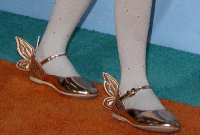 Moroccan Scott Cannon wears white stockings with flat Sophia Webster shoes featuring butterfly wings
