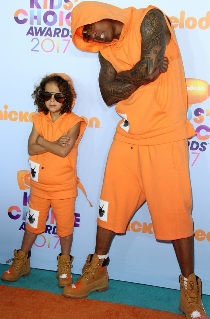 Nick Cannon and son Moroccan wearing matching orange outfits and tan boots customized with the Nickelodeon logo