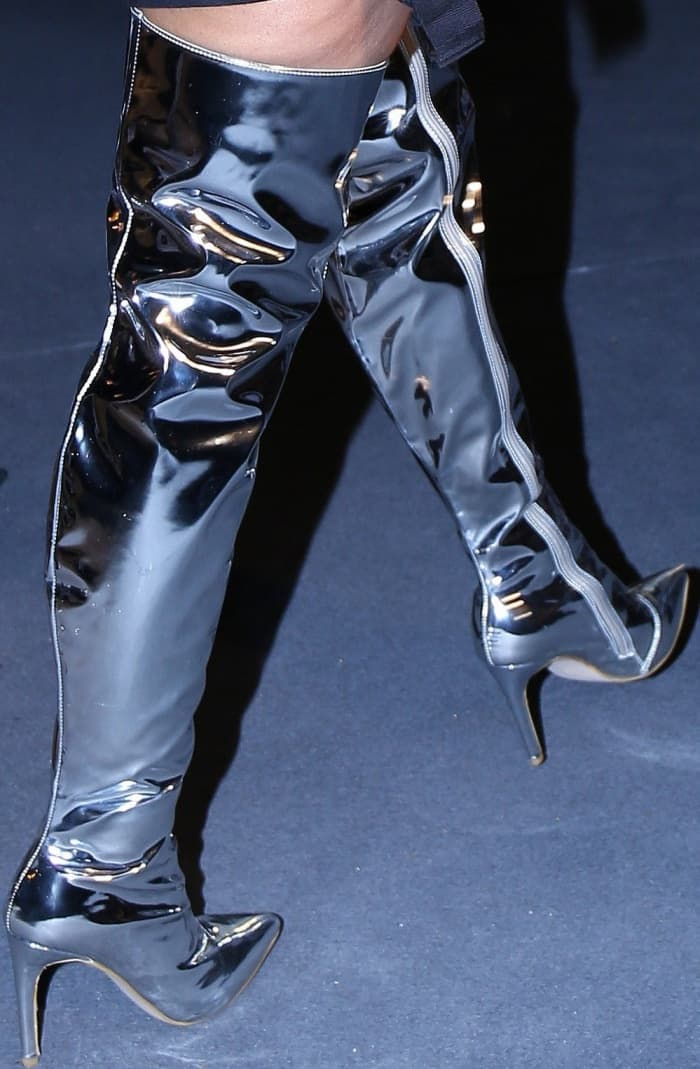 Nicki Minaj wearing Balenciaga mirrored thigh-high boots