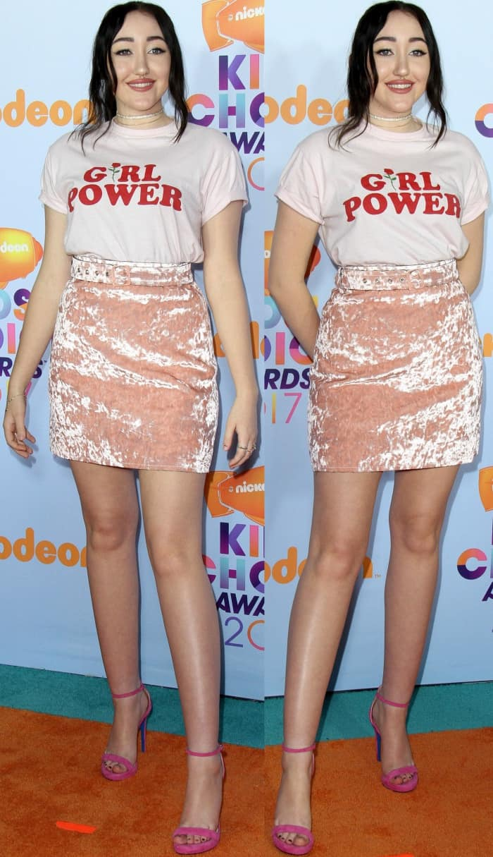 Noah Cyrus wearing a Glorious PJs Girl Power top, MSGM crushed velvet skirt, and Loriblu pink suede ankle-strap sandals at the 2017 Kids' Choice Awards