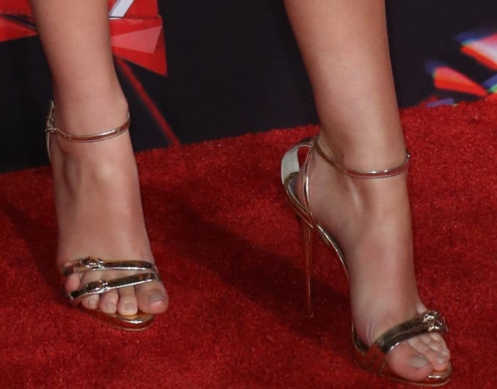Olivia Holt wearing gold ankle-strap sandals at the 2017 iHeartRadio Music Awards