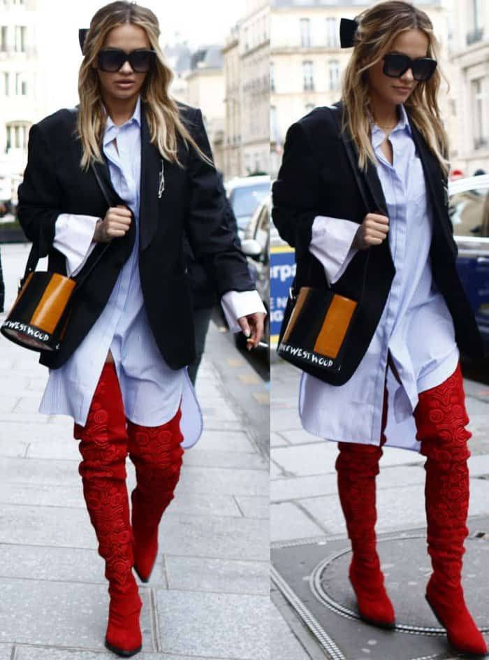 Rita Ora wearing a Vivienne Westwood oversized blazer, Jovonna London striped shirt dress, and red H&M thigh-high suede boots while out and about in Paris